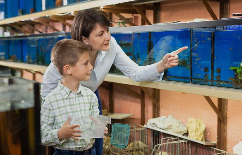 Mom and son in pet shop